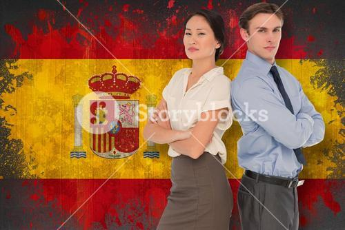 Composite image of business colleagues with arms crossed in office
