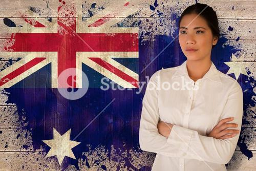 Composite image of casual businesswoman with arms crossed