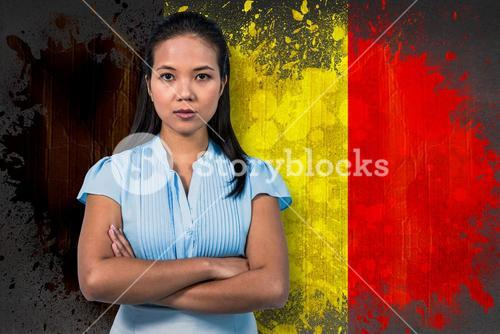 Composite image of serious businesswoman with arms crossed