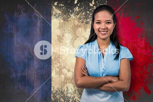 Composite image of smiling businesswoman with arms crossed