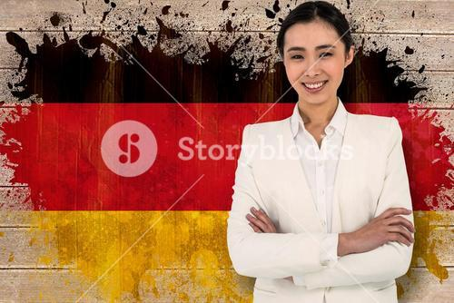 Composite image of smiling businesswoman looking at the camera