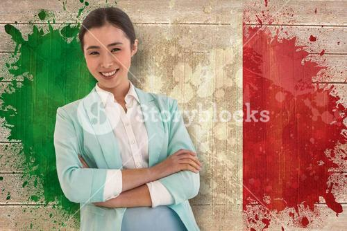 Composite image of smiling businesswoman with folded arms