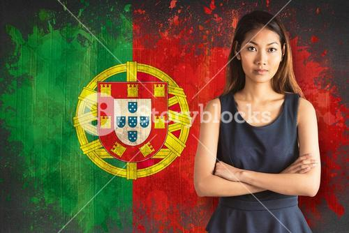 Composite image of businesswoman with crossed arms