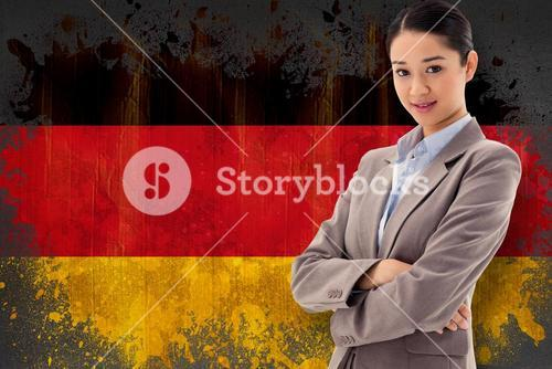 Composite image of portrait of a beautiful businesswoman posing with the arms crossed