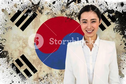 Composite image of smiling businesswoman smartly dressed