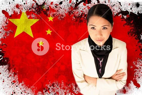 Composite image of businesswoman with arms folded