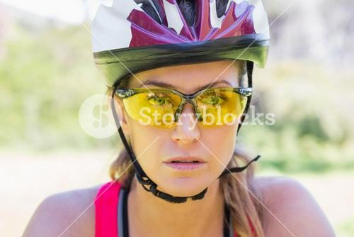 Focused woman cycling