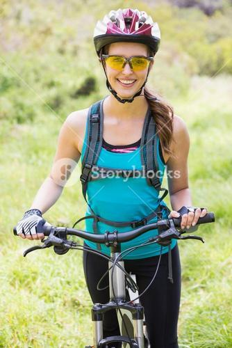 Smiling woman standing next to her bike