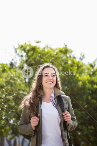 Smiling woman with backpack