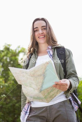 Smiling woman checking the map