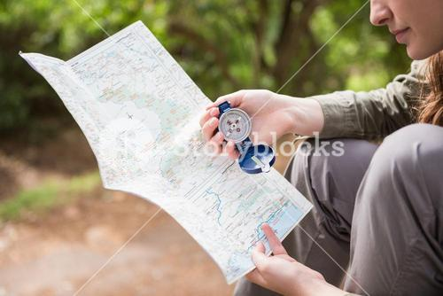 Woman checking map and compass