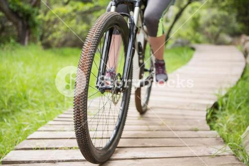 Close-up of woman cycling