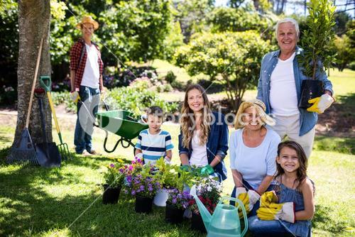 Multi-generation family gardening in the park