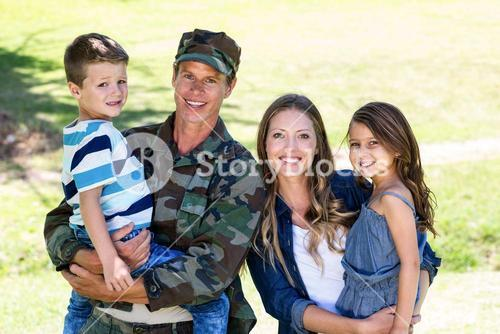 Soldier reunited with his family in the park