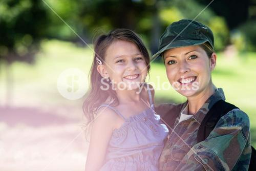 Happy soldier reunited with her daughter