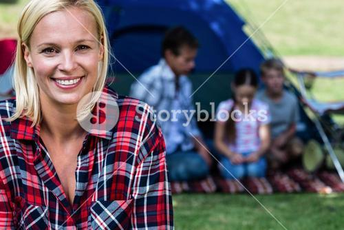 Portrait of a happy woman outside the tent