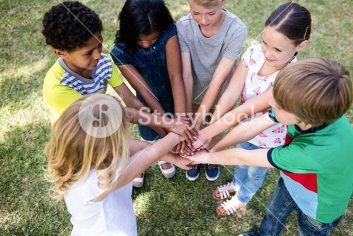 Children putting their hands together