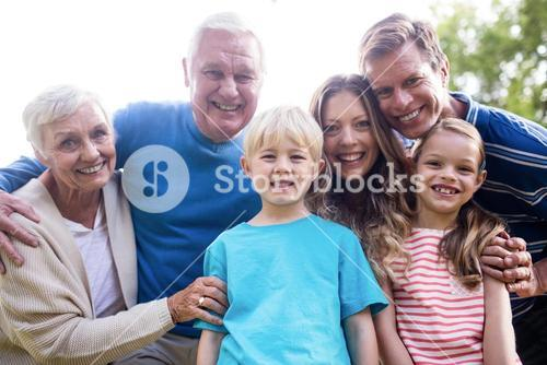 Multi-generation family standing in the park