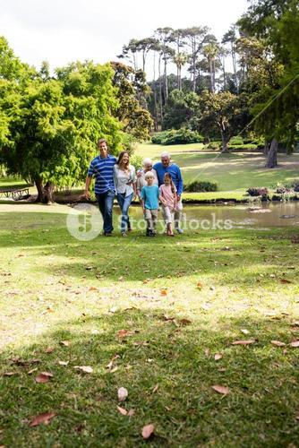 Multi-generation family walking in the park