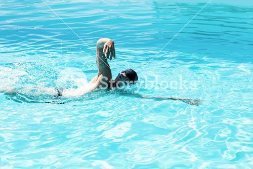 Fit swimmer doing the front crawl