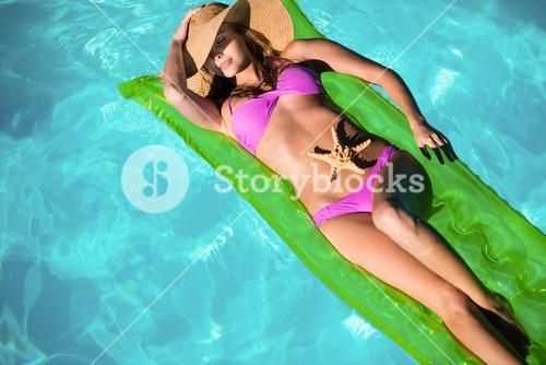 Woman relaxing on inflatable