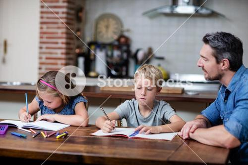 Father helping kids with their homework