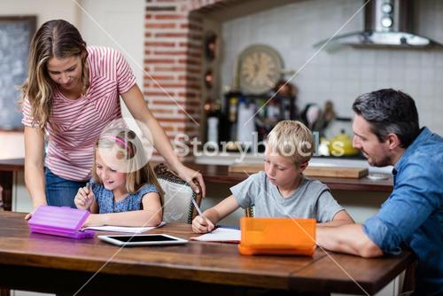 Parents helping the kids with their homework