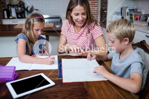 Mother helping kids with their homework