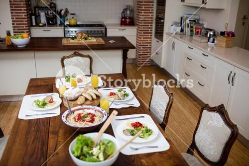 Dinning table laid with meal