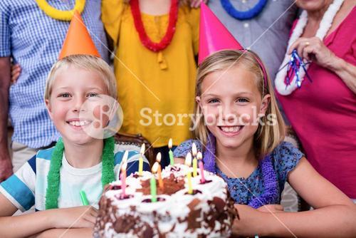 Siblings celebrating birthday party with family