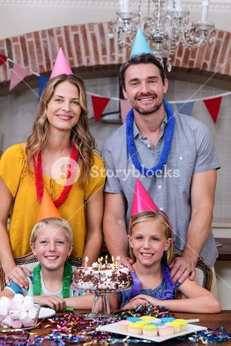 Portrait of family having fun at birthday party