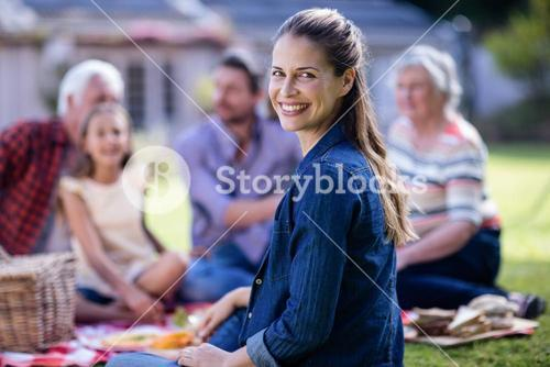 Happy woman having a picnic with her family