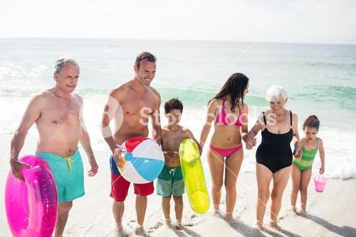 Happy family enjoying on beach