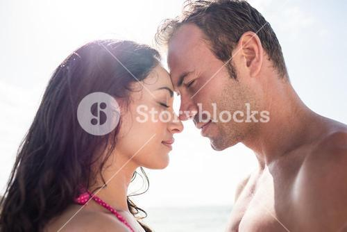 Romantic couple embracing face to face