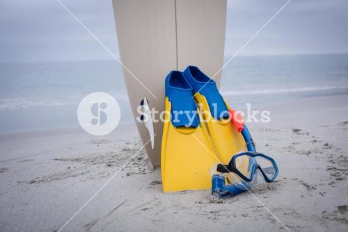 Surfboard with flippers and scuba mask