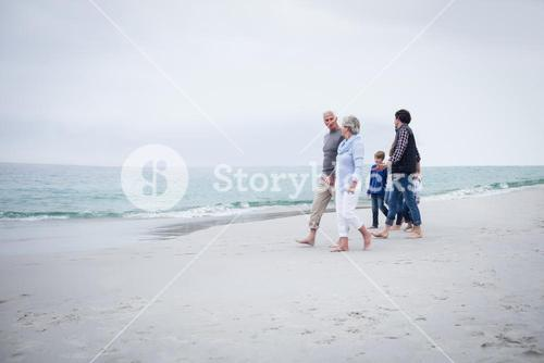 Family walking together on the beach