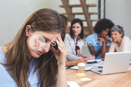Tense businesswoman sitting in office