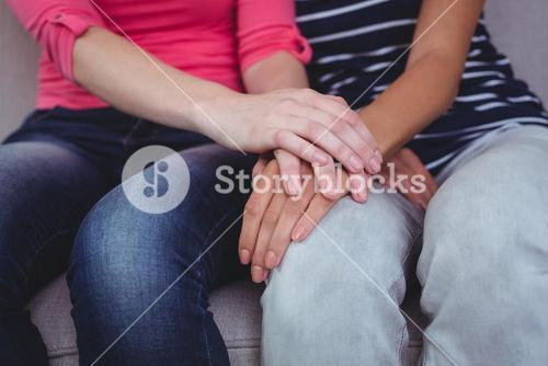 Mid section of a woman comforting her friend
