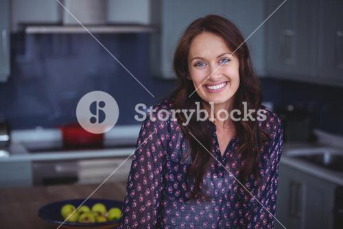 Beautiful woman smiling in kitchen