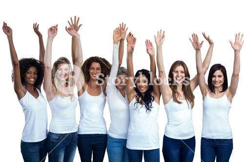 Happy multiethnic women standing with their hands raised