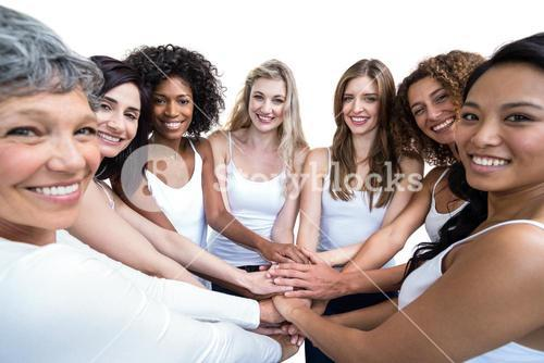 Women in a circle putting their hands together