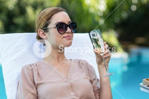 Business woman drinking champagne