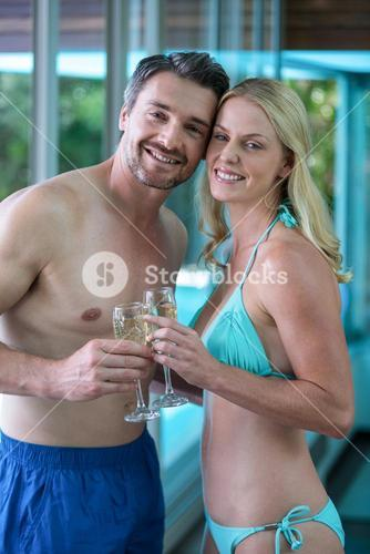 Couple romancing near the pool