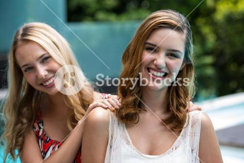Portrait of beautiful women smiling near pool