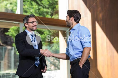 Businessman shaking mans hand