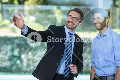 Real estate agent showing property to a man