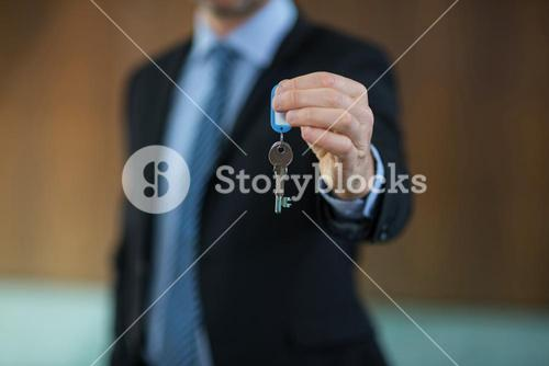 Real estate agent holding key