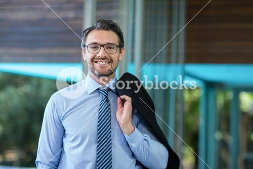 Businessman posing with hands in pocket in resort