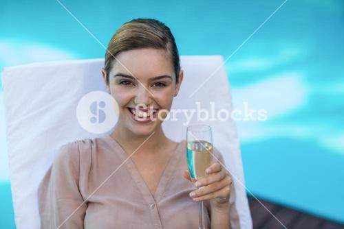 Businesswoman holding champagne flute