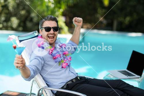 Excited man wearing garland and holding a martini glass